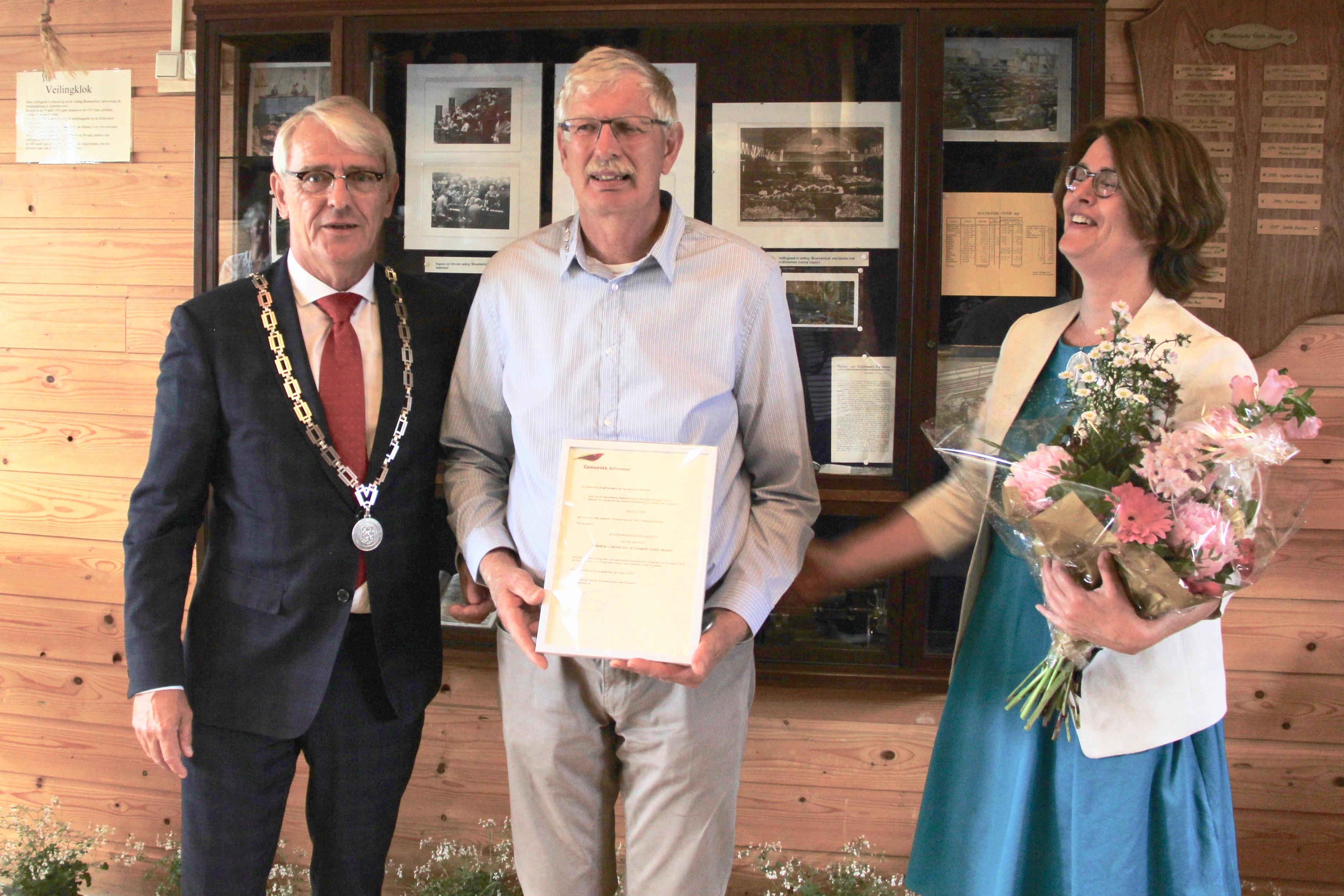 Rozenpenning voor tuinchef Cees van Dam